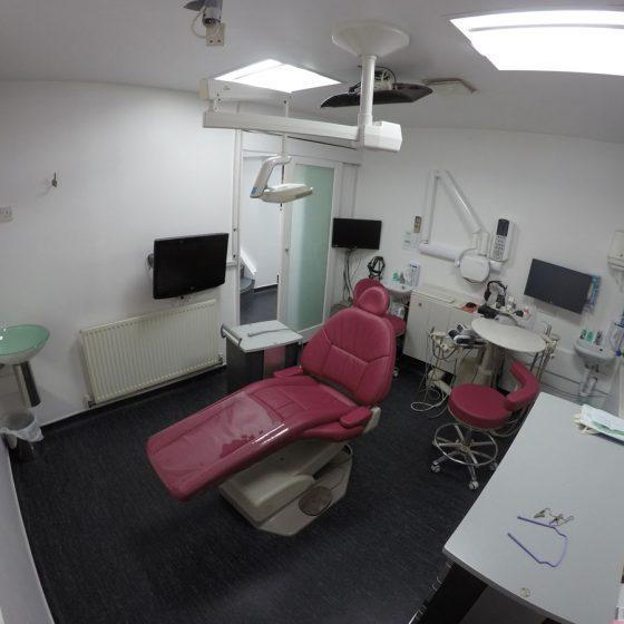 Dark pink dentist chair Blythe Road Dental Practice